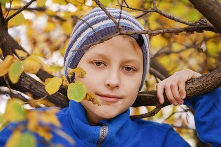 preteen boy portrait in the autumn park Archivio Fotografico - 149475839