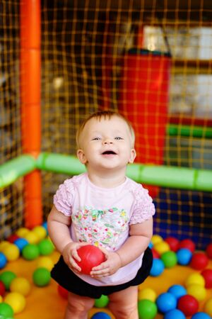 baby girl  in amusement park in ball pool Archivio Fotografico