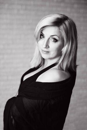 pretty sensual middle age blonde woman in the morning Archivio Fotografico - 149056693
