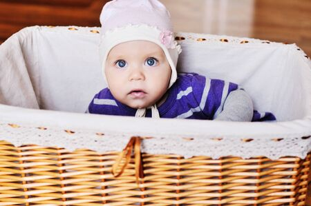sweet blue eyed baby girl in basket