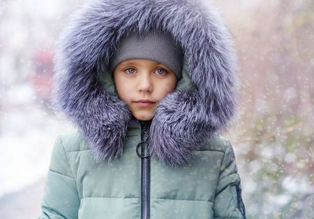 portrait of little girl in cold snow day