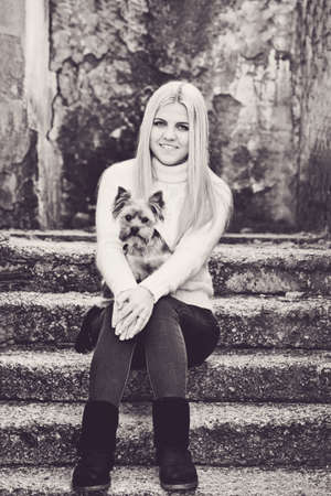 teen girl with little dog yorkshire terrier  in fall time Archivio Fotografico