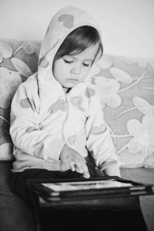 Cute toddler girl using tablet pc