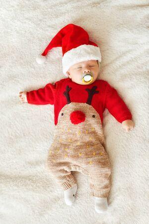 newborn baby boy wearing  Santa hat  and Christmas clothing Archivio Fotografico