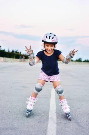 Little girl skating in the summer evening