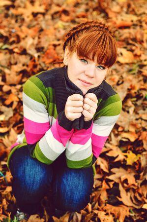 sweet redhead girl  on the fall meadow