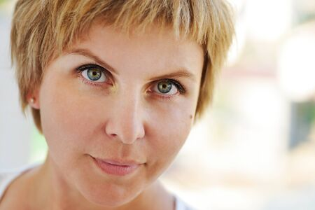 close up portrait of woman with blonde short hair