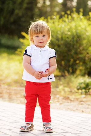 fashion toddler girl on the walk in summer