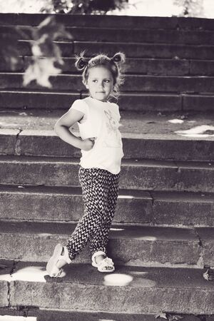 fashion little girl on the walk in summer Archivio Fotografico - 148970513