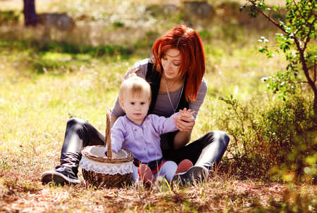 Mom and daughter on the fall meadow Archivio Fotografico