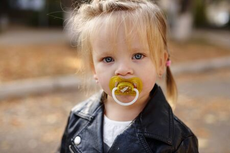 cute toddler girl with dummy on the walk Archivio Fotografico