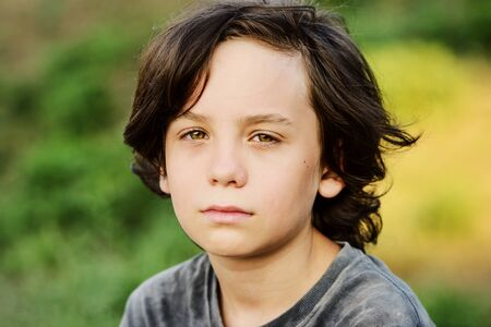 portrait of thoughtful preteen boy with long hair Archivio Fotografico