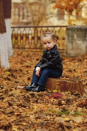 cute and funny toddler girl outdoors in fall Archivio Fotografico