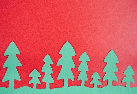 Green Paper Trees With Red Background photo