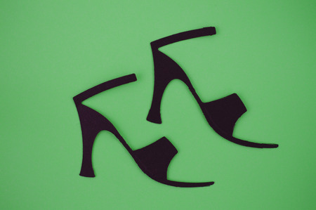 paper cut out: Paper cut out of women s sandals on green background Stock Photo