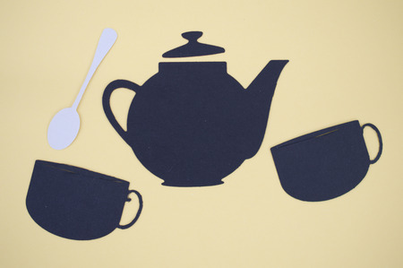 paper cut out: Paper cut out of tea pot, cups, and spoon