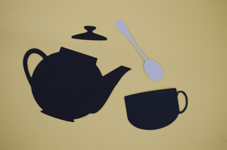 paper cut out: Paper cut out of pouring teapot with mug and spoon