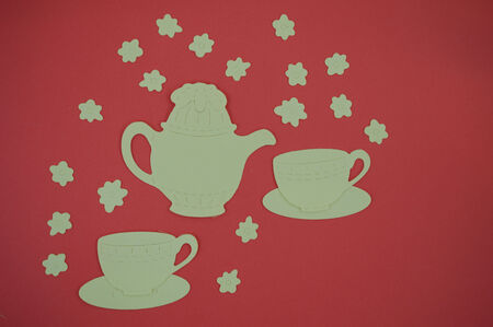paper cut out: Paper cut out of teapot and cups on red background