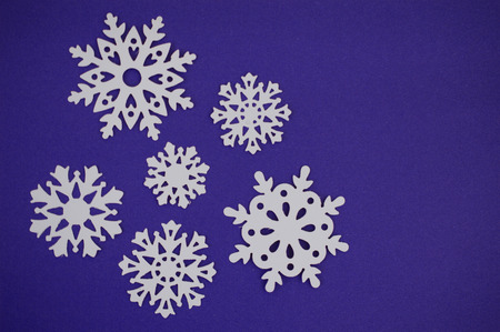 cut outs: Snowflake cut outs on blue purple background