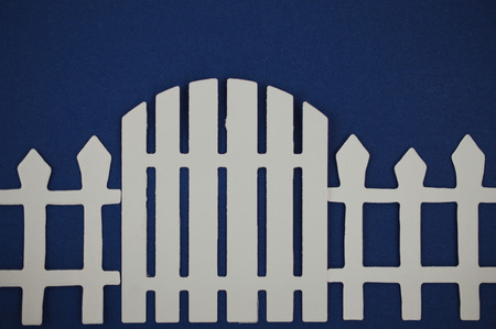 paper cut out: Paper cut out of gate of white picket fence
