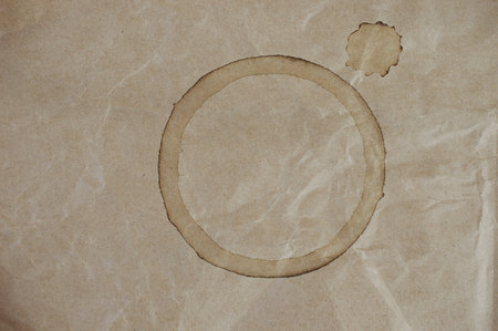 Coffee Cup Stain on Brown Crumpled Bag photo