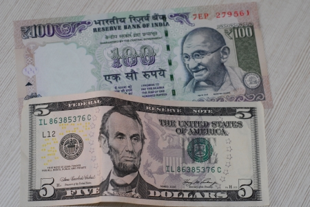 Indian rupees and US dollars photo