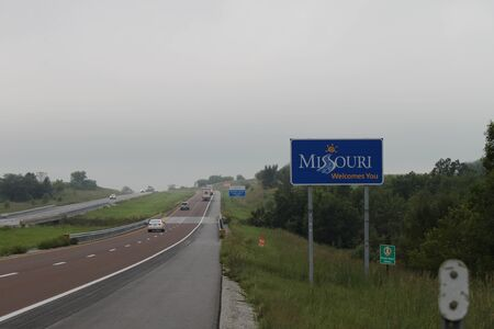 Eagleville, MO  US - Sept 9, 2019: A sign by the side of the Interstate 35 highway welcomes travelers to the state of Missouri.
