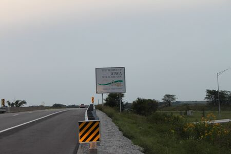 Eagleville, MO  US - Sept 9, 2019: A sign by the side of the Interstate 35 highway welcomes travelers to the state of Iowa.