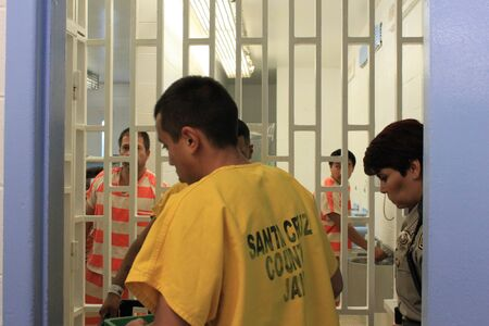 Nogales, Ariz.  US - March 8, 2011: Santa Cruz County Sheriffs Office deputies work with inmates in the old, outdated jail just before the opening of departments new facility. Editorial