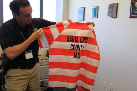 Nogales, Ariz.  US - March 8, 2011: Santa Cruz County Sheriffs Office Detention Division Commander displays an inmate uniform just before the opening of departments new jail facility. Editorial