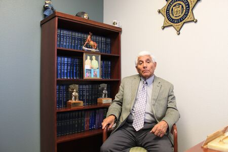Nogales, Ariz.  US - March 8, 2011: Santa Cruz County Sheriff Tony Estrada in his office just before the opening of departments new jail facility.