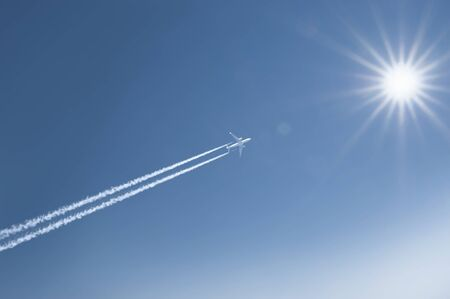 plane with the sun and sky Stock Photo