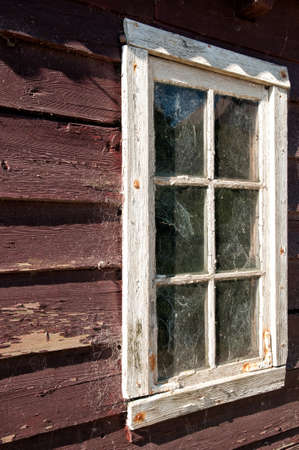 old windows with wooden facade photo
