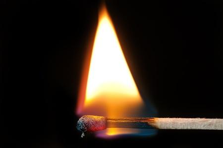 burning match on a black background Stock Photo