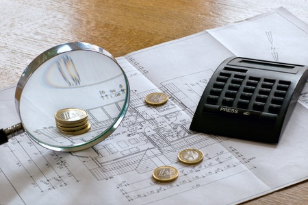 construction plan with money, calculator and magnifier