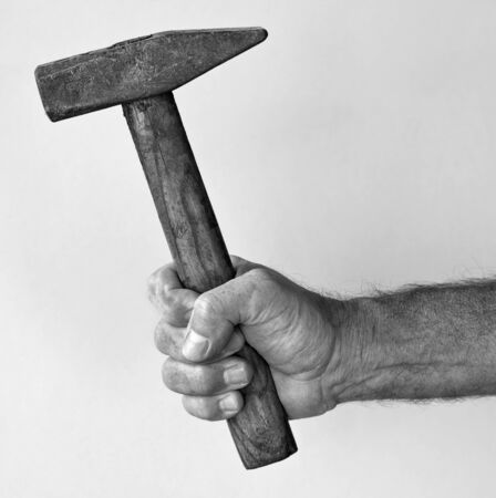 man hand with hammer in black and white