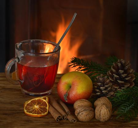 Tea with Früchten the fireplace