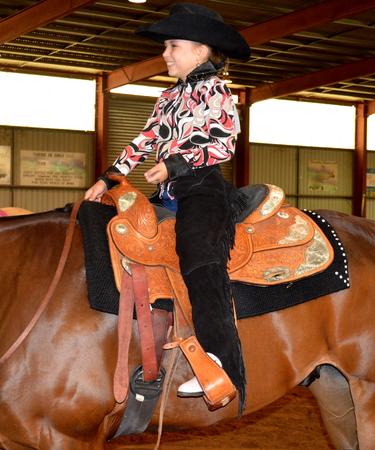 show horse: girl smiling riding show horse