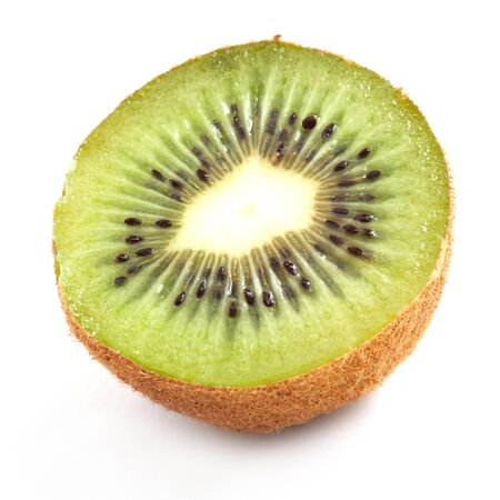 Kiwi cut in half on white background photo