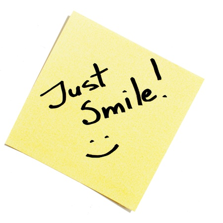 Sticky note reads: Just smile! Stock Photo - 8422676
