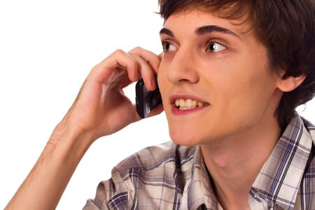 Young man talking by cellular phone on white background photo