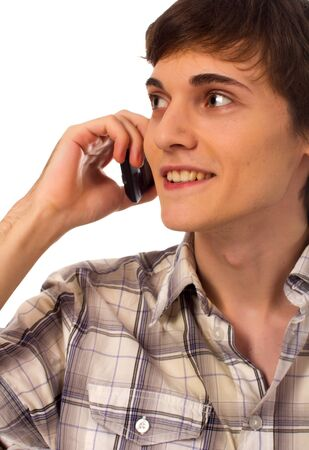 Young male using mobile phone talking on white background photo