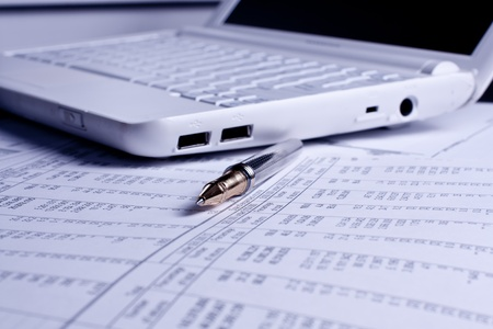 Various financial charts on the table with laptop and pen Stock Photo - 9130196