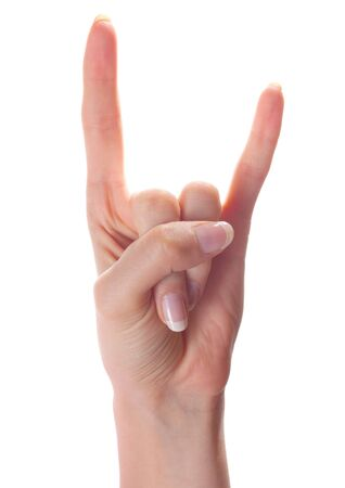 satanist: Woman hand showing horns gesture on white background