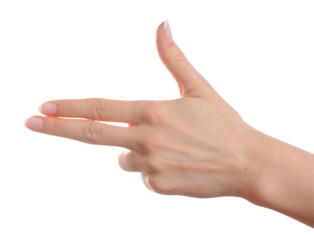 Woman hand showing gun gesture on white background
