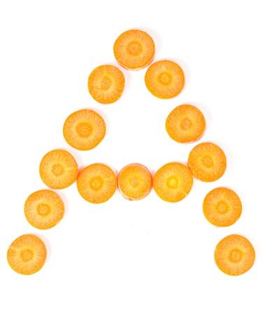 Carrot slices form letter symbolizing vitamin A