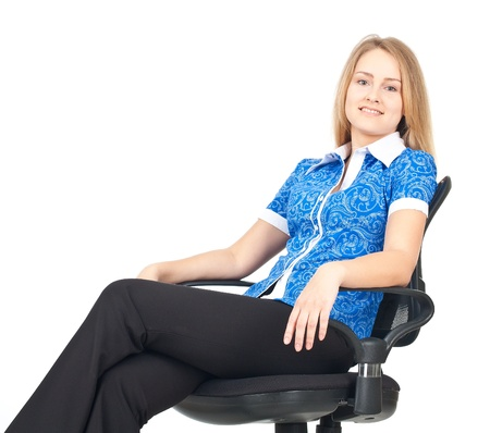 sexy office girl: Business woman sitting relaxed in office chair Stock Photo