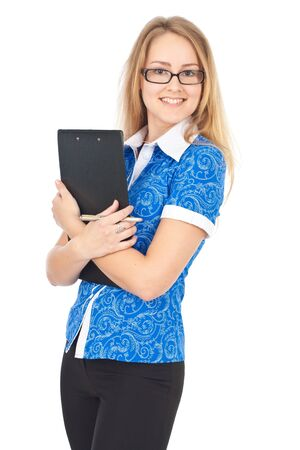 Attractive young business woman standing with clipboard and smiling Stock Photo