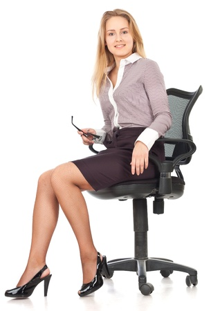 sitting: Young business secretary woman sitting in chair against white background