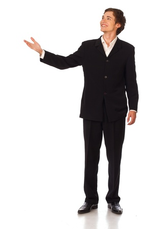 Young confident business man standing and smiling making presentation